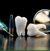 two teeth and dental tools