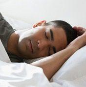 Man sleeping showing example of sleep apnea