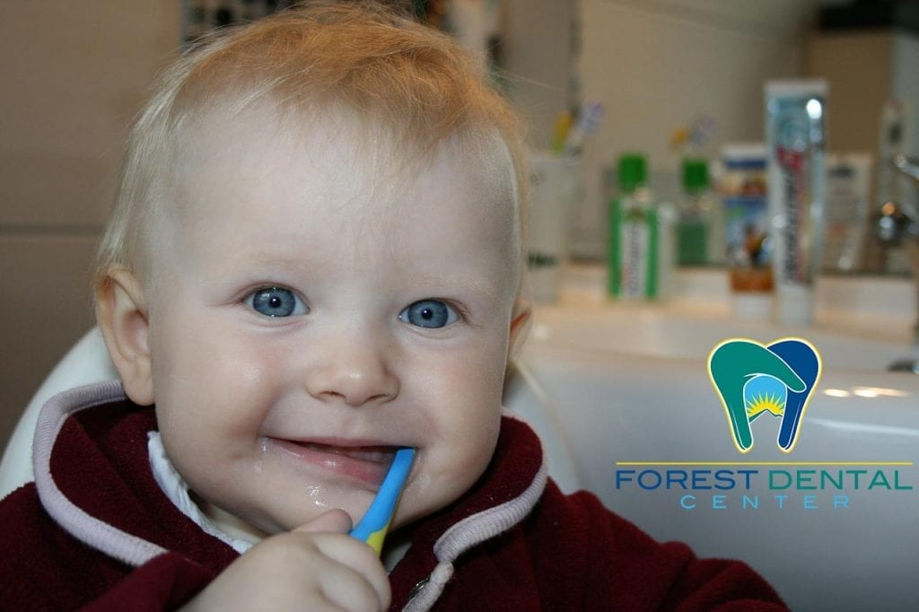 infant chewing on a tooth brush
