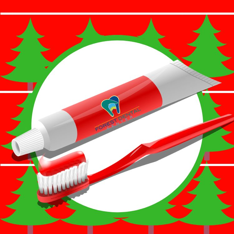 Forest dental center branded rendering of toothpaste and tooth brush on a christmas holiday background