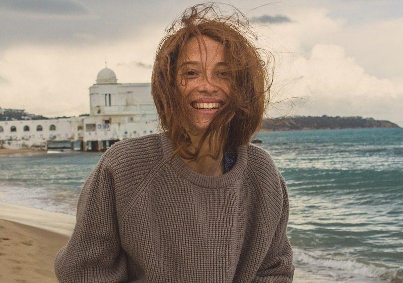 girl traveling by ocean smiling