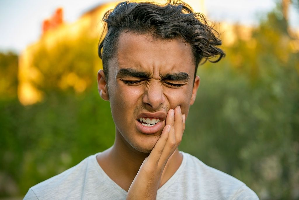 Man holding face from tooth pain